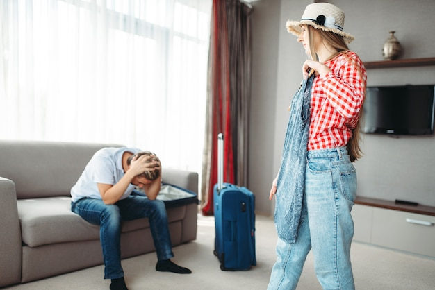 Wife chooses dress on a trip against tired husband