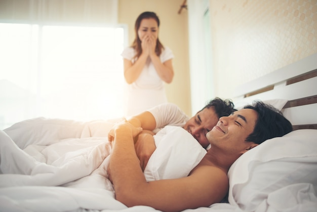 Wife found her husband in bed with another guy, he's gay