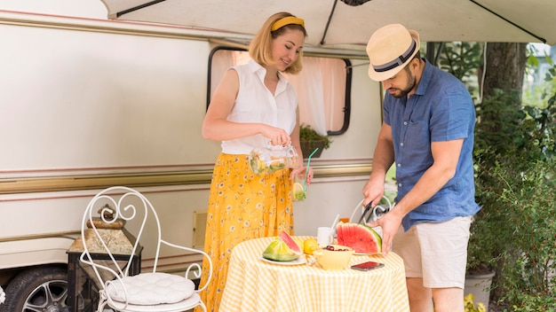 Wife and husband cutting a watermelon