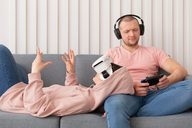 Wife and husband playing videogames at home
