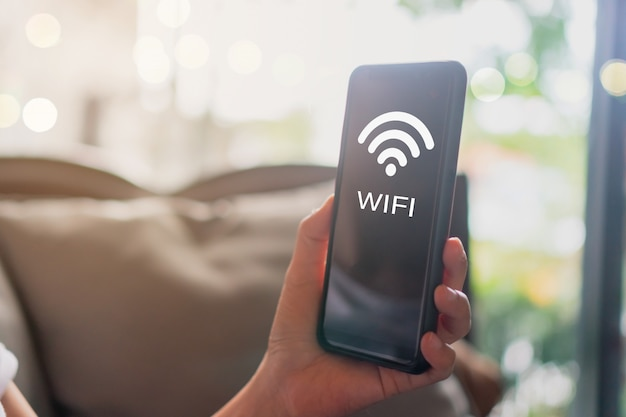 Wifi sign icon and connection screen of smartphone with top view city background. financial business technology freedom dream life.