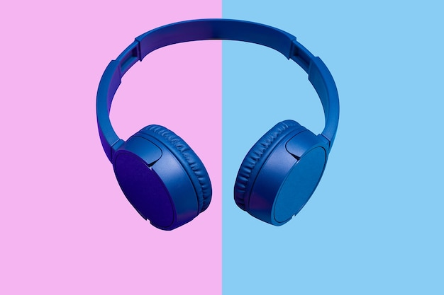 Wiireless headphones on vivid color background. flat minimal style. design and colors