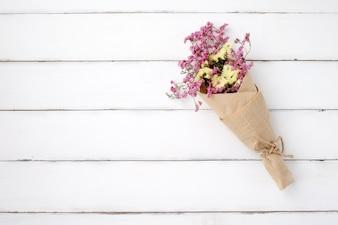 Wild flower bouquet on vintage white wood background