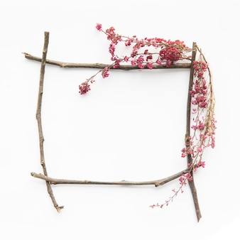 Wild flowers on frame from twigs
