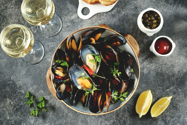 Wild mussels in shells with green onions garlic chili pepper and white wine