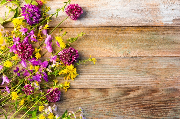 Wildflowers on a wooden rustic vintage background