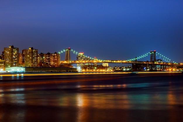 Williamsburg bridge at dusk spanning the east river
