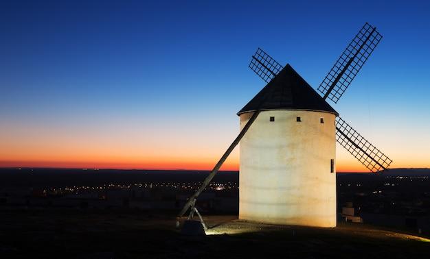 Wind mill at field in sunrise