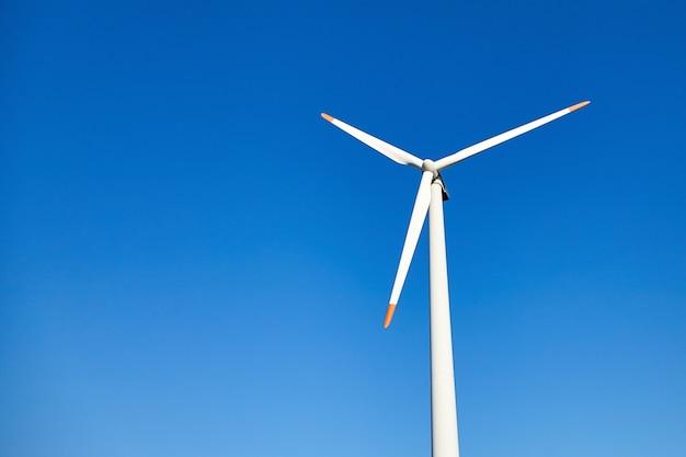 Wind power turbine against a blue sky