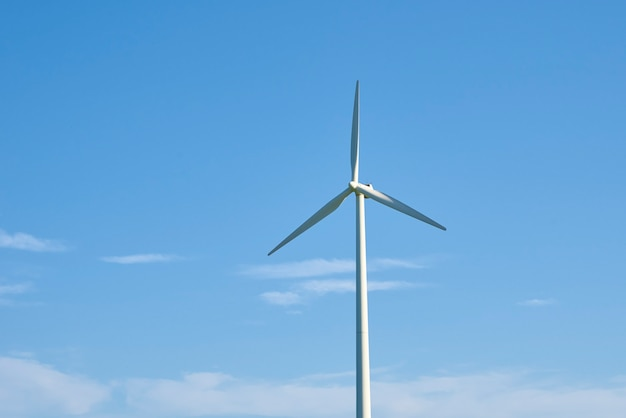 Wind turbine against blue sky. wind power energy concept. renewable energy for climate protection