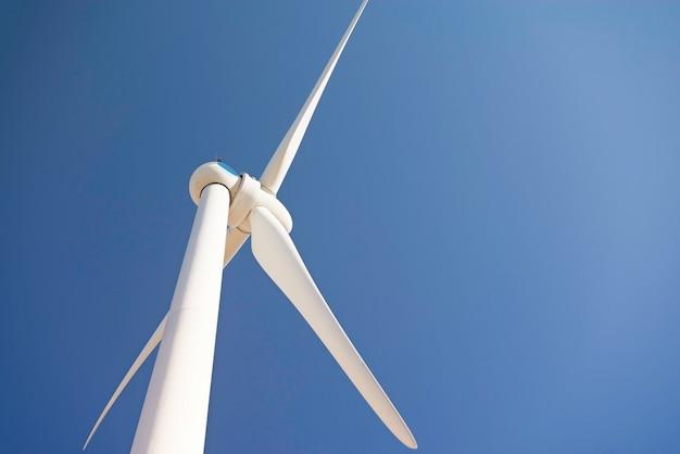 Wind turbine against a blue sky