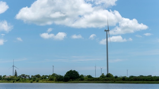 Wind turbine for alternative energy blue sky and cloud