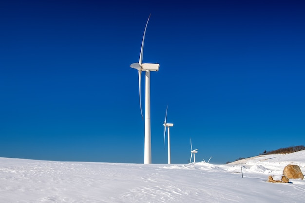Wind turbine and blue sky in winter landscape