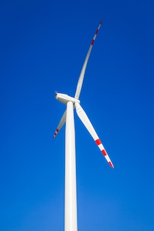Wind turbine on blue sky without clouds