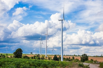 Wind turbine farm in beautiful nature with blue sky blackground, generating electricity