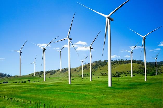 Wind turbine farm power generator in beautiful nature landscape for production of renewable energy