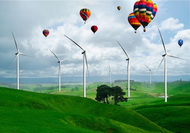 再生可能エネルギーの生産のための美しい自然の風景の中の風力タービンファーム発電機。