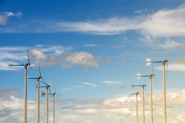 Wind turbine generating electricity, windmills for electric power ecology concept
