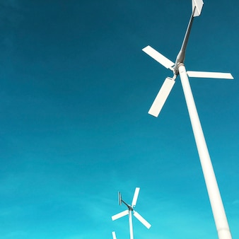 Wind turbine power generator with blue sky