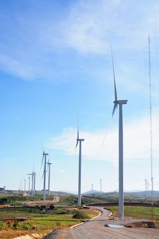 Wind turbine renewable energy source summer landscape with blue sky in natural landscapes