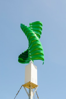 Wind turbine in the vertical spiral shape against blue sky background