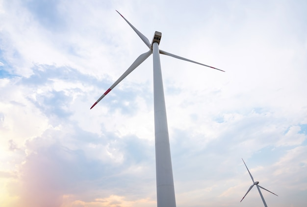 Wind turbine with blue sky and cloud in sunset. clean energy for save the world concept.