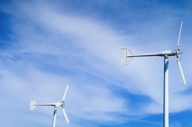 Wind turbines on blue sky.