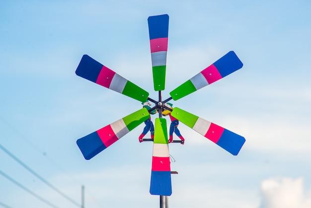 Wind turbines drive rotors and make animated cartoons