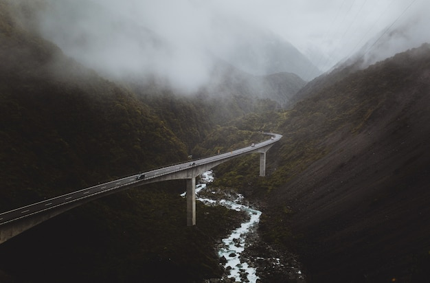 Winding highway bridge in foggy valley