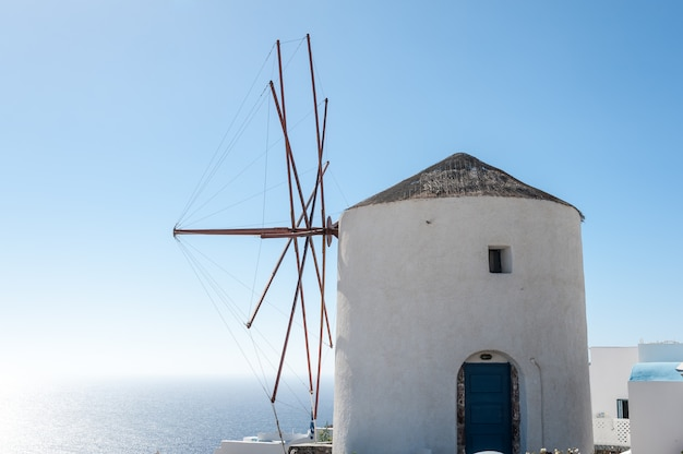 Windmill over the beautiful sea of santorini