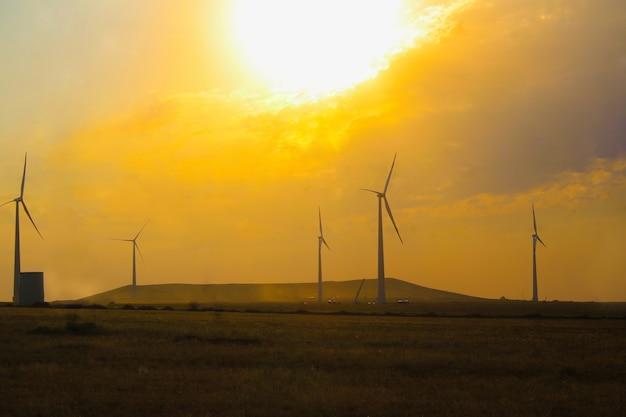 Windmill park, huge windmill generator turbines. alternative energy.