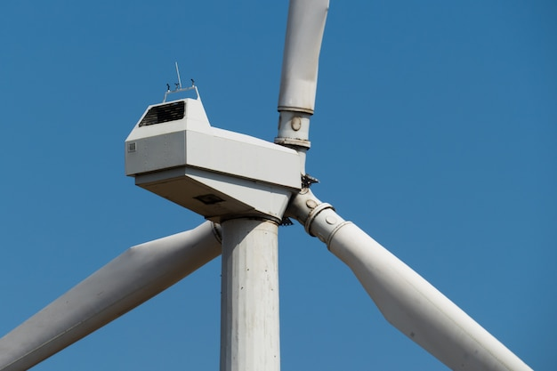 Windmill power generator against sky. close up