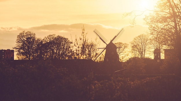 Windmill silhouette panoramic view at sunset