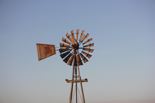 Windmill in the sunset sun