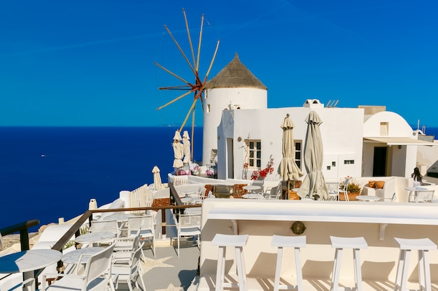 Windmill and white houses, oia, santorini, greece