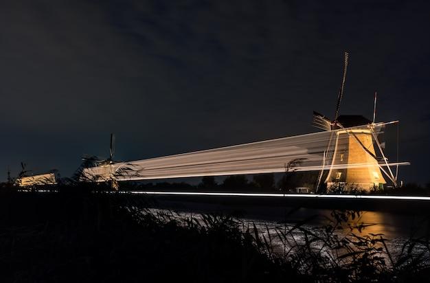 The windmills in kinderdijk are illuminated
