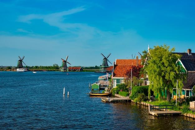 Windmills at zaanse schans in holland on sunset. zaandam, netherlands