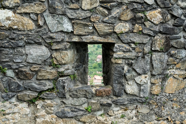 Window on the facade of a stone wall
