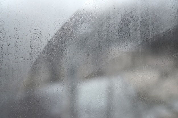 Window glass with condensate or steam after heavy rain, texture or background image
