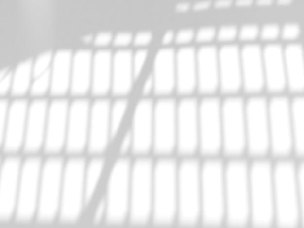 写真のモックアップ製品の白いコンクリートの背景にウィンドウの自然な影のオーバーレイ効果
