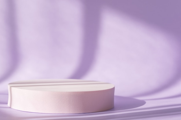 Window natural shadow overlay effect on purple surface, spring pastel theme. lilac backdrop with pink round podium, display, mockup. cosmetic product presentation with shadows and light from windows.