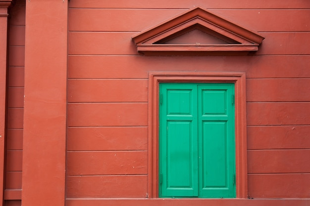 Window and red wall.