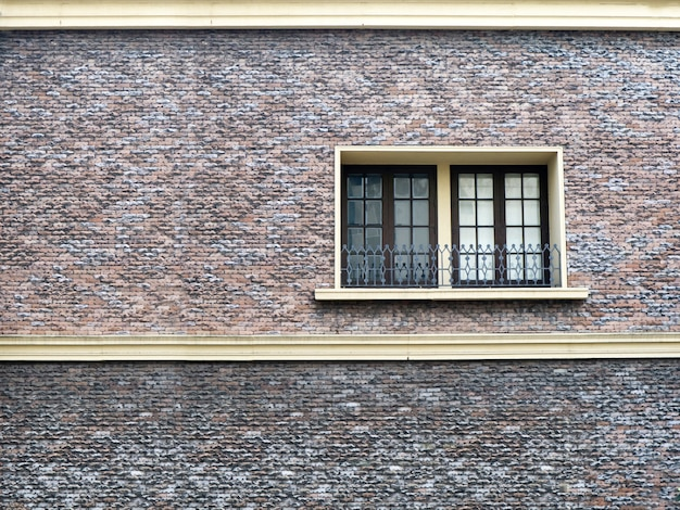 Window and sand stone brick wall interior outdoor