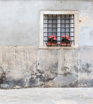Window with bars in the old house in venice italy