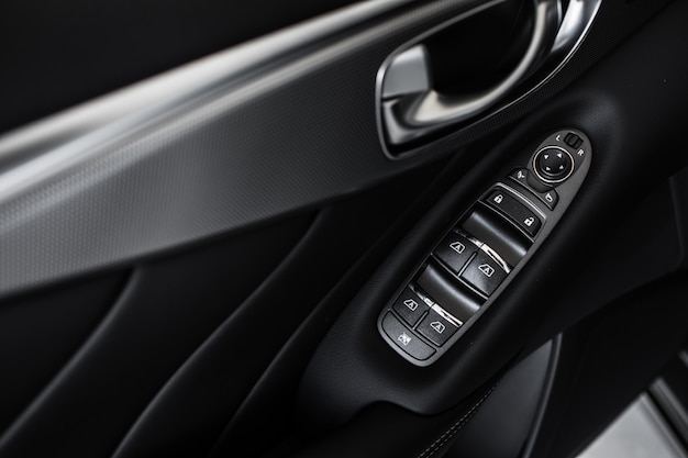 Windows control panel. details of stylish car interior, leather interior