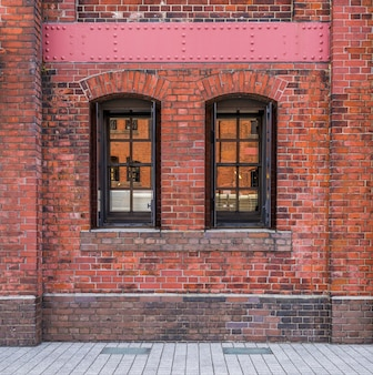 Windows in a red brick wall background