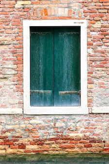 Windows of old house in venice, italy