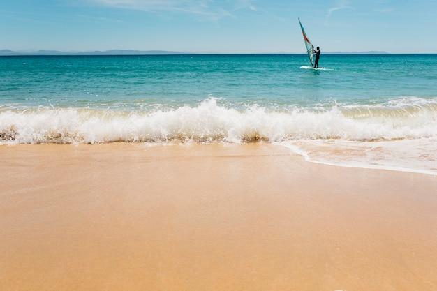 Windsurfing, fun in the ocean.