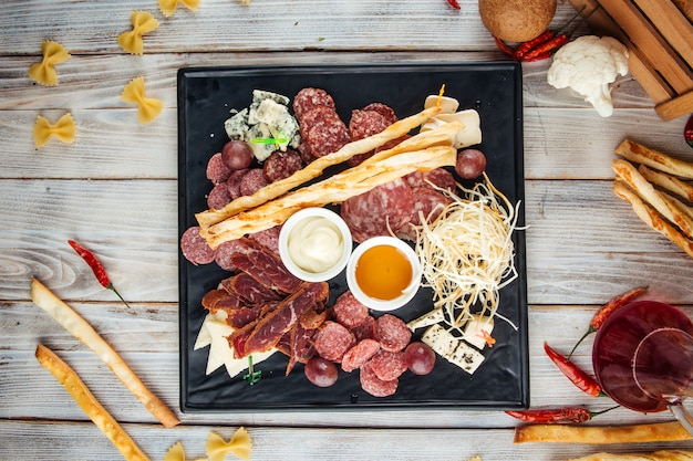 Wine appetizer set smoked sausages cheese honey