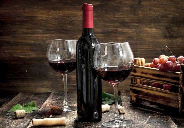 Wine background. red wine with a box of grapes.